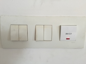 Light switches in my room; the one on the right is for the water heater