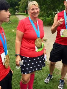 Done, sweaty, wearing my hard-earned bling!