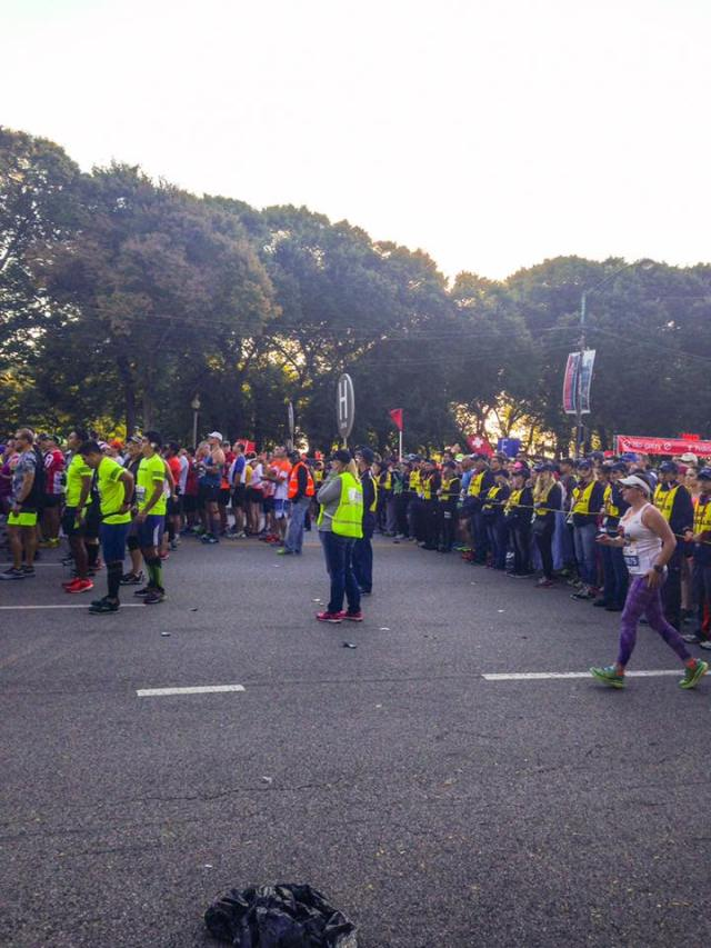 Me working corral H at the Chicago Marathon. I'm plugging my ear trying to hear what they are saying over the radio as we bring our runners toward the start line. Pretty electric! Photo credit: Cathy M.